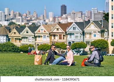 Young people in park at Alamo Square in San Francisco, California, USA