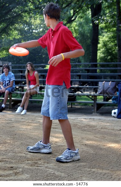young people playing frisbee