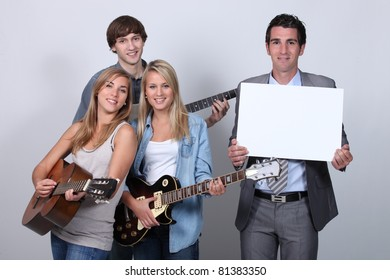 Young people playing the guitar