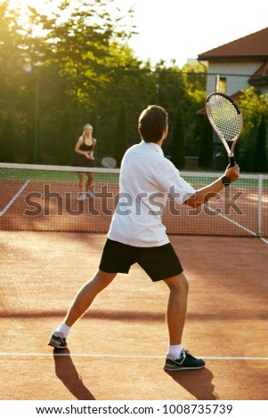 Young People Playing Tennis Outdoors Healthy Stock Photo Edit Now