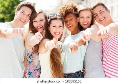 Young people pointing at you