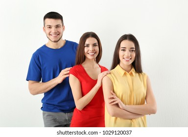 Young people posing together on light background. Unity concept