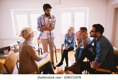 Young people with problems listening to their nervous friend confession while sitting together on special group therapy.