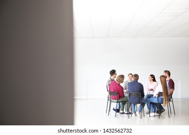 Young people with psychologist at group therapy session