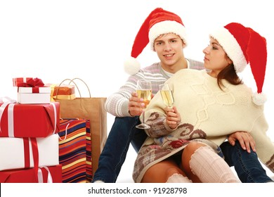 Young people in santa hat drinking champagne, isolated  on white background