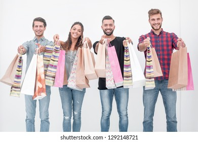 young people showing their colorful shopping bags