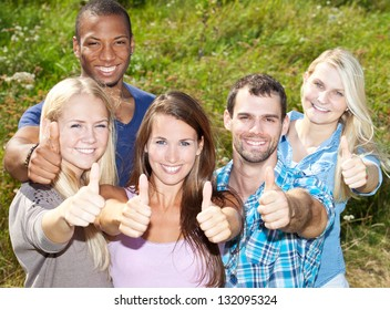 Young people showing thumbs up.