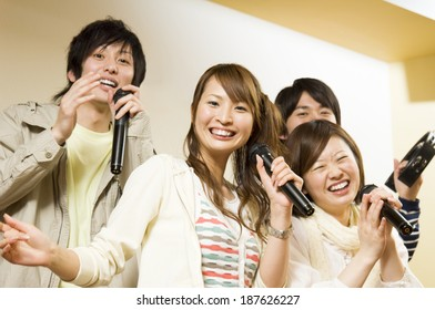 young people singing at karaoke