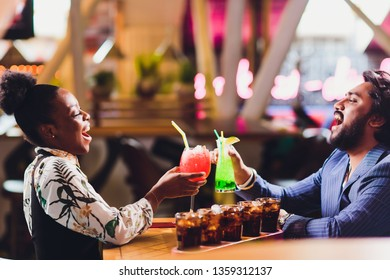 young people sitting in a cafe and talking. Young man and woman meeting at cafe table.