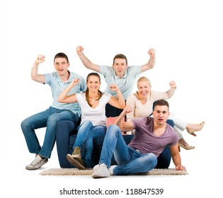 Young people sitting on a sofa cheering, on white background