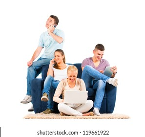 Young people sitting on the sofa with their gadgets
