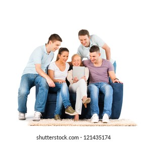 Young people sitting on a sofa, looking at a tablet, on white background