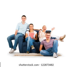 Young people sitting on a sofa smiling, on white background