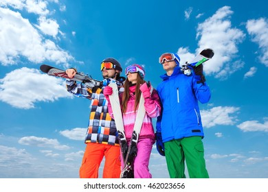 Young people with skis in winter