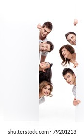 young people smiling behind advertising banner