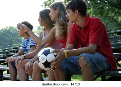 young people with soccer ball