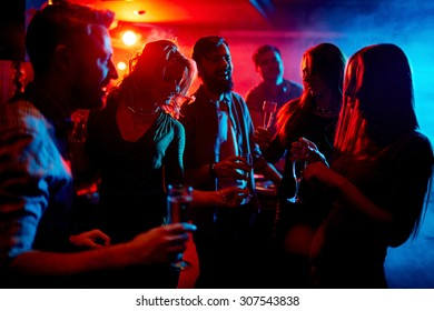 Young people spending time at nightclub