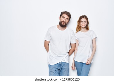 young people stand near the wall jeans light T-shirt