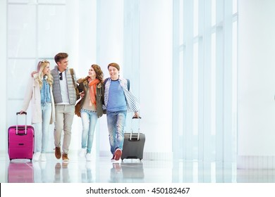 Young people with suitcase in airport