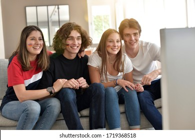 Young people supporting France national team on tv