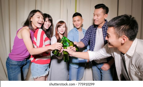 young people take beer and smile happily with party