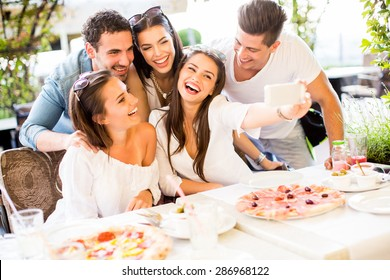 Young people taking photo by the table