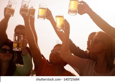 Young People in their twenties on the Venice Beach boardwalk in California drinking beer