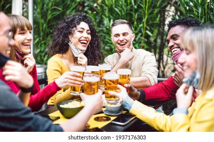 Young people toasting beer wearing open face mask - New normal life style concept with friends having fun together outside at brewery bar garden - Warm filter with focus on woman in yellow clothes