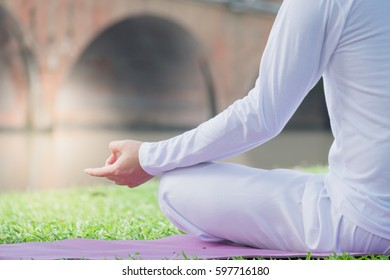 Young people training yoga and meditation in the park