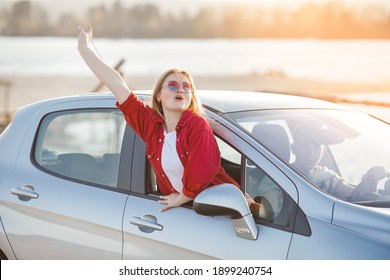 Young people traveling by car. Couple having an automobile trip.