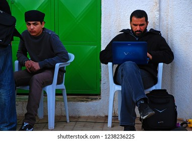 Young people are trying to connect with their relatives on the Internet. Internet club in Benghazi, Libya. April 6, 2011, Benghazi, Libya.