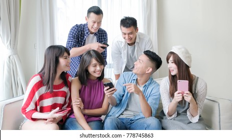 young people use phone and smile happily
