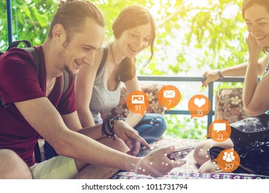 Young people uses the phone for entertainment and communication on the Internet and viewing notifications in the form of icons. The concept of social network and media