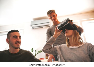 Young People Using VR In The Living Room