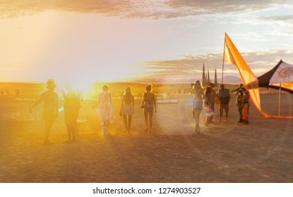 Young people walking towards the sun