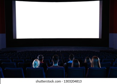 Young people watching movie in cinema theatre. Space for text