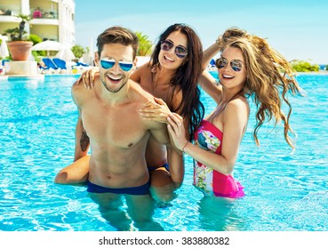Young People Wear Sunglasses And Having Fun In Swimming Pool