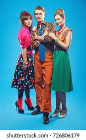 Young people wearing colorful old-fashion clothes in pinup style