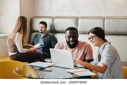Young people work in light office.