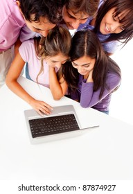 Young people working on a laptop - isolated over white