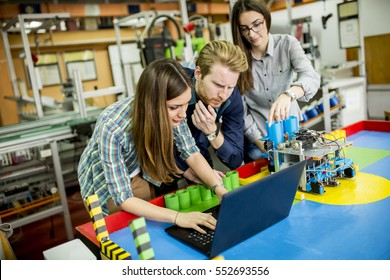 Young people working in the robotics classroom