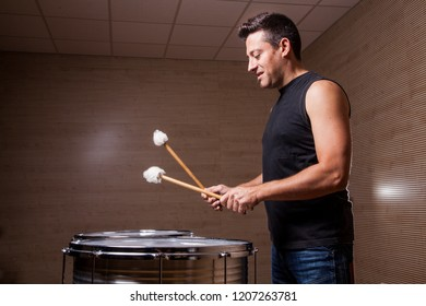 young percussionist practicing with two drums in the rehearsal studios
