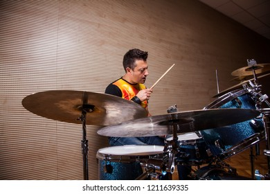 young percussionist rehearsing playing the drums in rehearsal studio