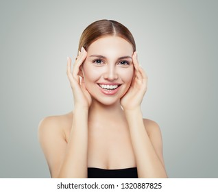 Young perfect woman with cute smile laughing and looking at camera