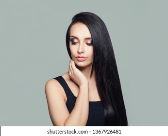 Young perfect woman with long dark straight hair and makeup portrait