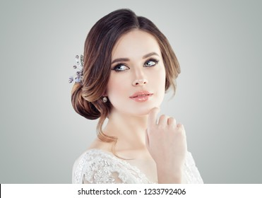 Young perfect woman with makeup, updo hair and hairdeco