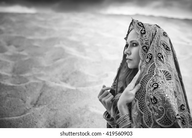 Young Persian princess looking into the distance. Black and white processing for dramatic look.