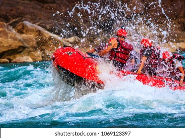 Young person rafting on the river Ganges in Rishikesh, extreme and fun sport at tourist attraction