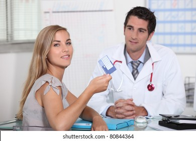 Young person showing European health card