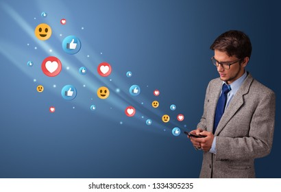 Young person using smartphone with flying social media icons around